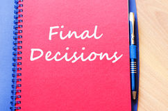 Final decisions write on notebook Stock Image