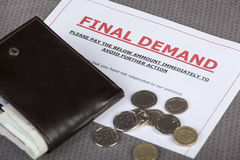 Final demand on a table with cash and wallet. Final demand laying on a table with some loose cash and wallet Stock Image