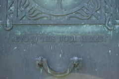 Final Door. An aged copper decorative vault door with its final message on a mausoleum in a historical western Pennsylvania cemetery. Beyond this door is rest Stock Photography