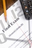 Final Exam 2. A final exam lays on a desktop ready to begin.... only 90 minutes to complete royalty free stock photo
