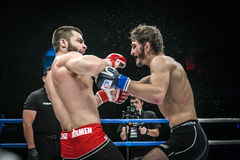 Final fight of MMA fighters. splashing water and sweat Stock Photo