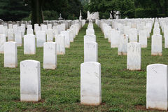 Final Formation. Rows of tombstones in a military graveyard Stock Photos