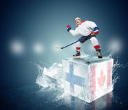 Final game Finland vs Canada. Hockey player on ice cube Stock Image