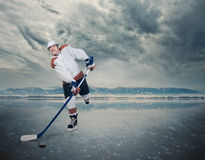 Final game. Hockey player on ice cube royalty free stock photography