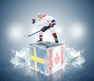 Final game Sweden vs Canada. Hockey player on ice cube Stock Photo