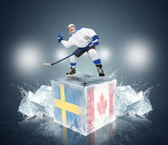 Final game Sweden vs Canada. Hockey player on ice cube Royalty Free Stock Photo