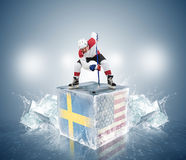 Final game Sweden vs USA. Hockey player on ice cube Stock Image