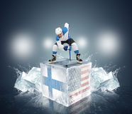 Final gameFinland vs USA. Hockey player on ice cube Royalty Free Stock Photography
