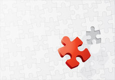 Final jigsaw piece on puzzle. Large red final jigsaw piece on blank puzzle with one piece missing, leadership concept Stock Images