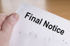 Final notice. Hand holding final notice or reminder letter stock photography