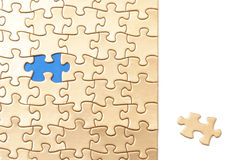 The Final Piece. To the golden puzzle lies in a section of bright white where any text may be inserted to communicate a conceptual message royalty free stock photos