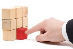 The final piece. Business man putting the final piece into place - achievement concept Stock Photo