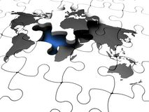 The final piece. 3D render of a jigsaw puzzle of a world map with the final piece lifted out Stock Photo