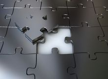 Final piece of jigsaw puzzle. Final piece of a metal jigsaw puzzle - teamwork Royalty Free Stock Images