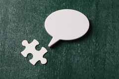 Final piece of puzzle. And speech bubble royalty free stock image