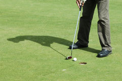 Final putt on golf course Stock Image