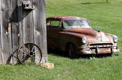 Final Resting Place. Old rusty car, old tobacco barn, wagon wheel, and bird house. Appalachian Mountains Royalty Free Stock Photo