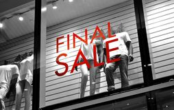 Final sale. Sign, highlighted in red colour on a black and white background Royalty Free Stock Photos