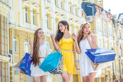 Final sales. Girls holding shopping bags and walk around the sho Stock Image