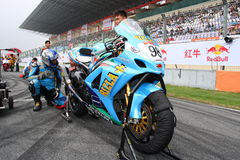 Final tunning. Jimmy Chan from Hong Kong is doing the final adjustment with his crew on his Suzuki GSXR1000 before the start of the race in ZIC Superbike of 2009 Stock Image