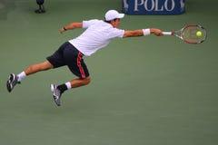 Finalista 2014 del US Open Kei Nishikori durante partido final contra Marin Cilic en Billie Jean King National Tennis Center Foto de archivo libre de regalías