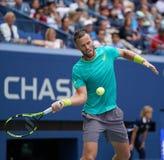 Finaliste Michael Venus de doubles mélangés de l'US Open 2017 du Nouvelle-Zélande dans l'action pendant le match final Photo stock