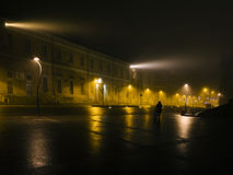 Finally coming home. One young woman finally coming home during a foggy and misty night, Monza, Italy royalty free stock photography
