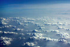 Perfect clouds from an airplane. White clouds and a blue sky, viewed from an airplane. Picture taken over Europe Stock Image