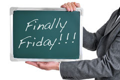 Finally friday. A businessman holding a chalkboard with the text finally friday written in it Stock Images