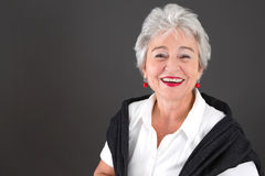 Finally retire - grey haired attractive woman. Retired attractive woman - smiling & happy Stock Photo