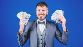 Finally rich. Business startup loan. Currency broker with bundle of money. Bearded man holding cash money. Rich. Businessman with us dollars banknotes. Making stock image