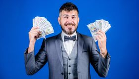Finally rich. Business startup loan. Currency broker with bundle of money. Bearded man holding cash money. Rich. Businessman with us dollars banknotes. Making stock images