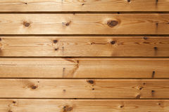 Finally slatted natural brown wood texture on house. Finally slatted natural brown wood texture on house Royalty Free Stock Photos