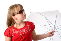 Finally it stopped raining. Small girl in red clothes with umbrella and sunglasses looking as if it finally stopped raining isolated on white Stock Photography