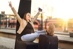 Finally on vacation. Woman celebrating at train station. Finally on vacation. Woman celebrating at train station to leave on fun trip. Happy smiling person with Stock Images