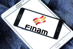 Finam Holdings logo. Logo of Finam Holdings on samsung mobile. Finam Holdings is a financial services company headquartered in Moscow, Russia. It is the parent Stock Photography