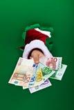 Finançant les vacances - les euro billets de banque t'ont remis Photographie stock