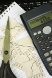 Finance. Instruments: calculation, calculator and newspaper Royalty Free Stock Photo