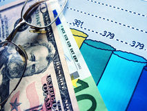 Finance. Money laying on the table of an exchange rate of currency royalty free stock image