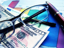 Finance. Money laying on the table of an exchange rate of currency stock photo