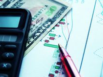 Finance. Money laying on the table of an exchange rate of currency Stock Image