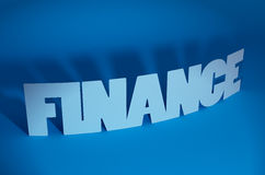 Finance. Text in blue background Royalty Free Stock Photo