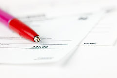 Finance. Red pen on top of financial statements Royalty Free Stock Photo