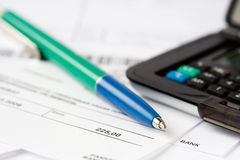 Finance. Pen and calculator on top of financial statements Stock Images