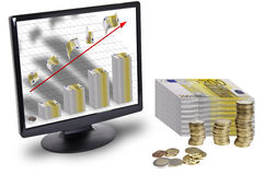 Finance. This image shows a lot of money and a screen with a graph made with bank notes and a red arrow upwardly out of the screen Stock Image