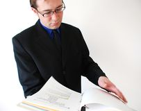 Finance. Businessman checking reports and financial papers Royalty Free Stock Photos