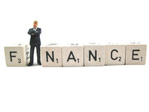 Finance. A businessman standing in the word finance stock images
