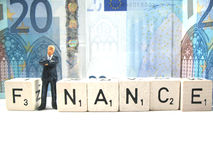 Finance. A man standing in front of a twenty euro bill stock photography
