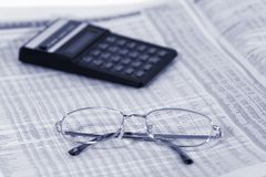 Finance. Financial numbers, glasses and calculator Royalty Free Stock Images