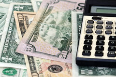 Finance. American dollar bills and a calculator Stock Photos